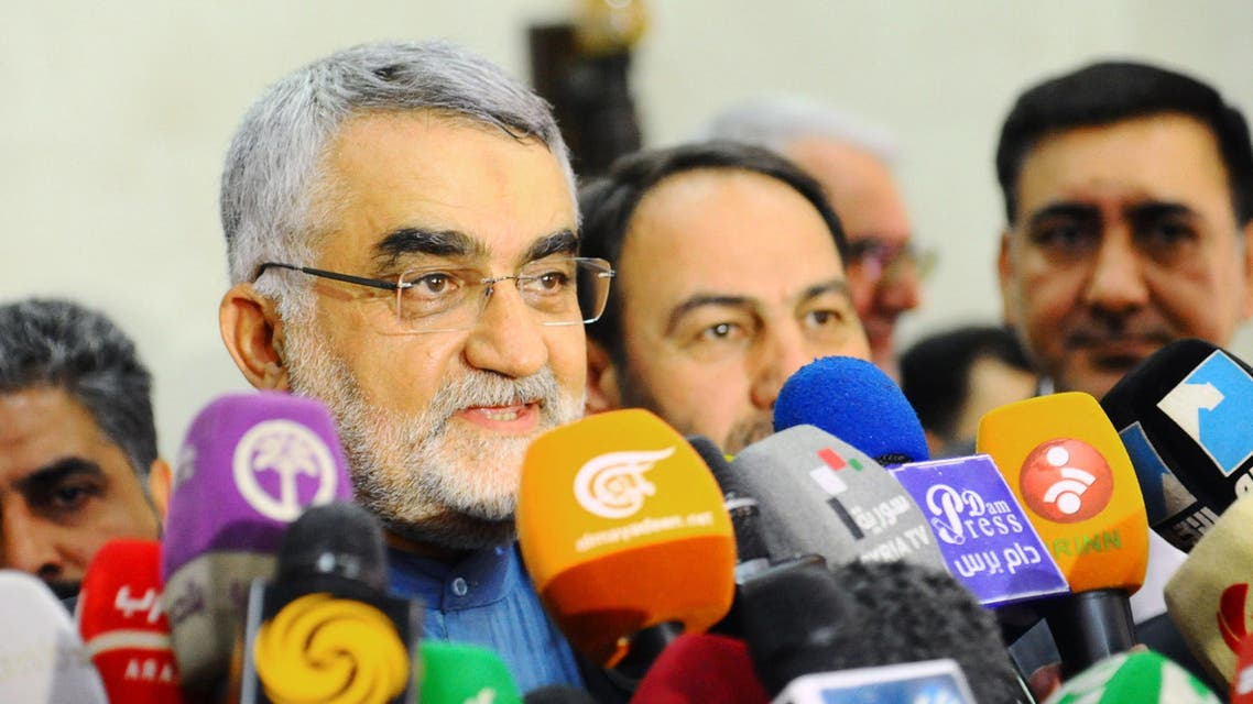 Chairman of the Foreign Policy and National Security Committee at the Iranian Shura Council, Alaeddin Boroujerdi (C), speaking to the press following a meeting with Syrian officials in the capital Damascus. (AFP)