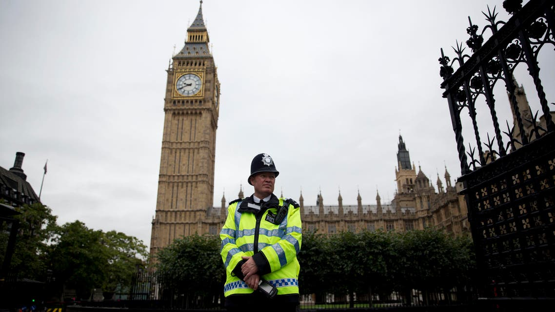 n this Monday, Sept. 1, 2014 file photo, a British police officer stands guard outside the Houses of Parliament in London. The military-style daylight attack on the streets of Paris on Wednesday, Jan. 7, 2015. (AP)