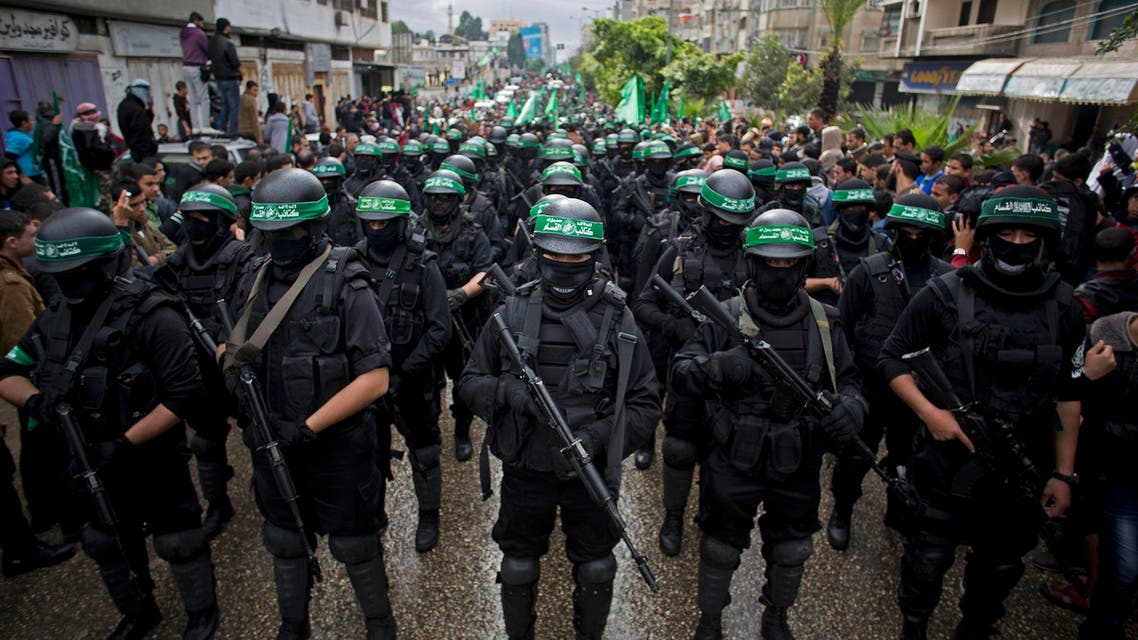 In this Dec. 14, 2014 file photo, masked Palestinian Hamas gunmen perform their military skills during a rally to commemorate the 27th anniversary of the Hamas militant group, in Gaza City. AP
