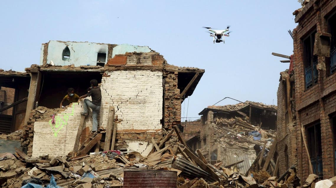 A drone flies over buildings destroyed after the earthquake in Nepal in April. (Reuters)