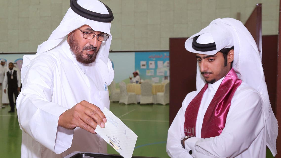 A Qatari man casts his vote for municipal elections at a polling station in Doha, Qatar,Wednesday, May 13, 2015. AP