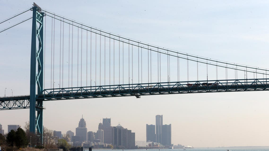 In a photo from April 29, 2015, the Detroit skyline is seen under the Ambassador Bridge. (AP