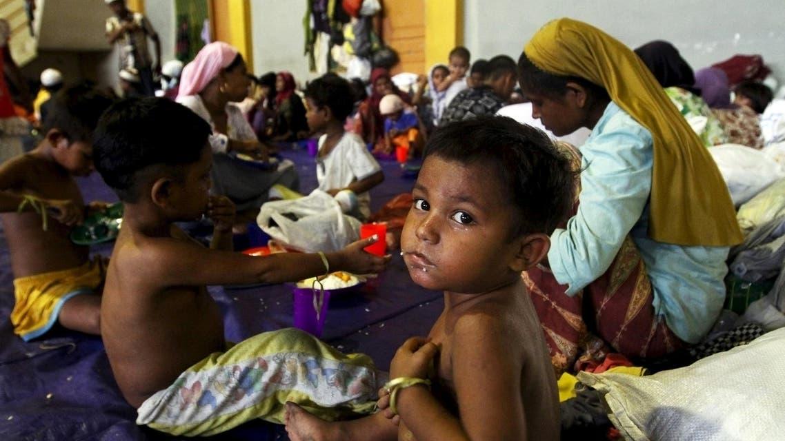 أعضاء من أقلية الروهينجا الذي فروا من الاضطهاد في ميانمار