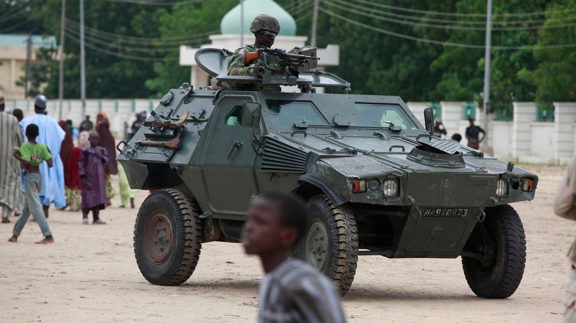 Nigerian soldiers ride on an armored personnel carrier during Eid al-Fitr celebrations in Maiduguri, Nigeria. AP