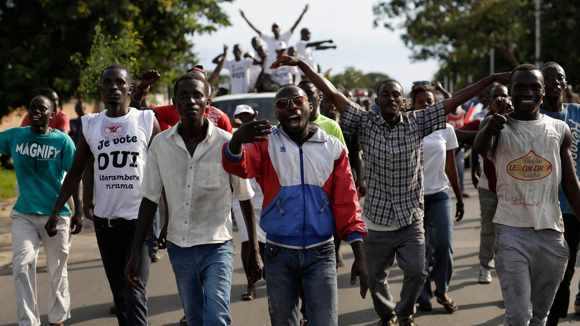 Supporters of President Pierre Nkurunziza celebrate his return in the streets of Bujumbura, Burundi, Friday May 15, 2015. AP