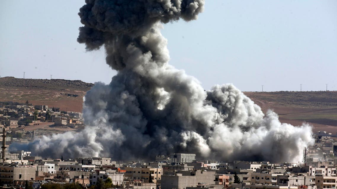 Smoke rises over the town of Kobani during airstrikes by the US led coalition, seen from the outskirts of Suruc, near the Turkey-Syria border, Wednesday, Oct. 29, 2014. (AP)