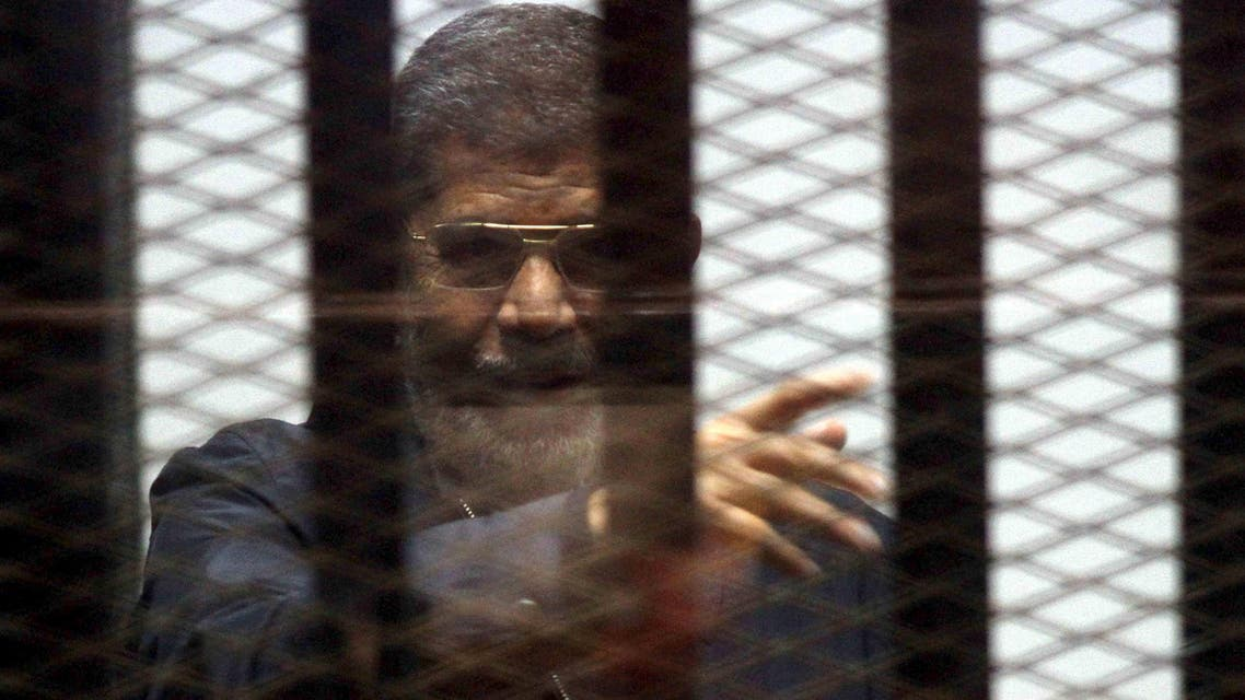 Ousted Egyptian President Mohamed Mursi is seen behind bars during his trial at a court in Cairo. Reuters