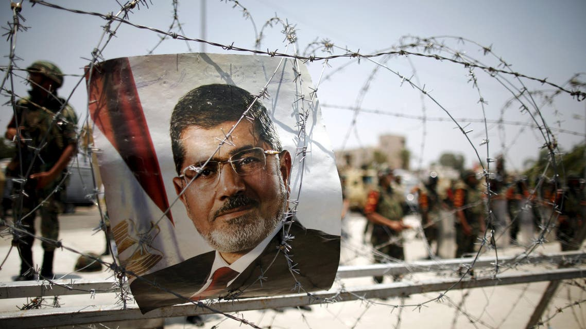 A portrait of deposed Egyptian President Mohamed Mursi is seen on barbed wire outside the Republican Guard headquarters in Cairo. (File: Reuters)