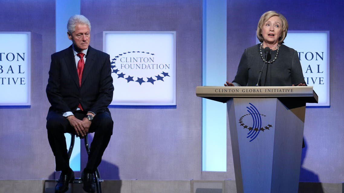 Former Secretary of State Hillary Rodham Clinton and former U.S. President Bill Clinton appear together on stage during a plenary session at the Clinton Global Initiative, Monday, Sept. 22, 2014 in New York. (Photo by Greg Allen/Invision/AP)