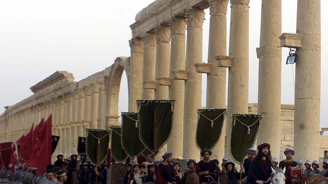 """A symbolic trade caravan representing the prosperous trade during the era of Queen Zanobya 260-273AD during a show held in the ancient city of Palmyra, some 240 kilometers (150 miles) northeast of Damascus Friday, Sept. 27, 2002. The show was organized by the Syrian Tourism Ministry for World Tourism Day. The two-day festival was called """"on the road of Harir or (silk)"""". (AP photo/Bassem Tellawi)"""