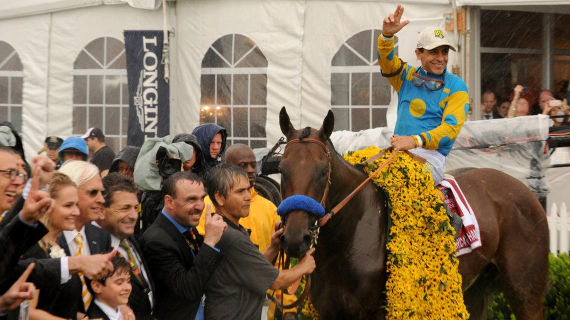 IMAGE DISTRIBUTED FOR LONGINES - For the second year in a row, jockey Victor Espinoza celebrates winning the second leg of the Triple Crown at the 140th Preakness Stakes, Saturday, May 16, 2015, at Pimlico Race Course in Baltimore, Md. American Pharoah will be a contender for the Triple Crown at Belmont Park on June 6. Longines, the Swiss watch manufacturer known for its elegant timepieces, is the Official Watch and Timekeeper of the 140th annual Preakness Stakes and the Triple Crown. (Photo by Diane Bondareff/Invision for Longines/AP Images)