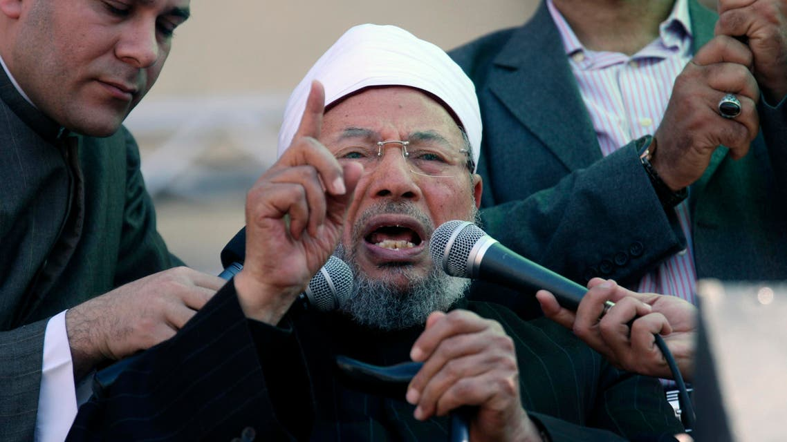 Egyptian cleric Sheik Youssef el-Qaradawi speaks to the crowd as he leads Friday prayers in Tahrir Square in Cairo, Egypt, Friday Feb. 18, 2011.  AP