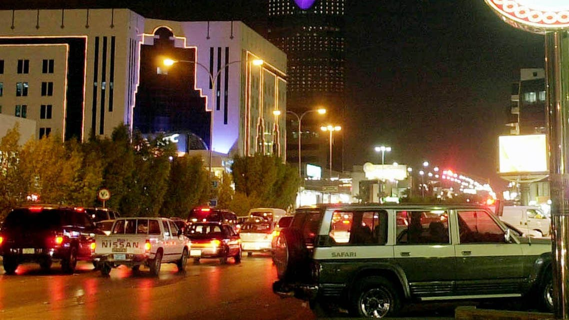 Cars crowd Olaya Street, overshadowed by Al-Mamlika Tower, in Riyadh's main business and shopping district, Oct. 3, 2002. The ruling Al-Saud family has modernized Saudi Arabia with oil money that has given the kingdom one of the region's best infrastructures, the latest technology and shopping centers. However, there are differences within the family on how to modernize further without adopting too many Western ways. (AP Photo/Hasan Jamali)