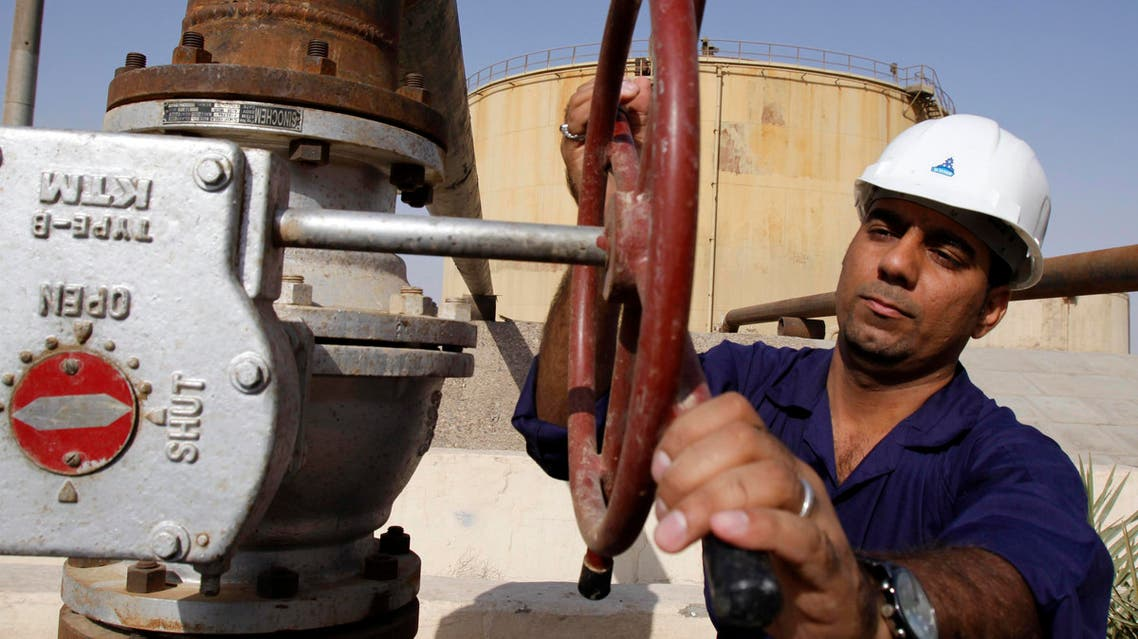 An Iraqi worker operates valves at the Rumaila oil refinery, near the city of Basra, 550 kilometers (340 miles) southeast of Baghdad, Iraq, Sunday, Dec. 13, 2009. Lukoil and Norway's Statoil ASA took the biggest prize in the closing round of the two-day bidding: the 12.88 billion barrel West Qurna Phase 2 field in the Basra region. The deal was a coup for the Russian firm, which had been promised the field under Saddam Hussein's regime. (AP Photo/Nabil al-Jourani)