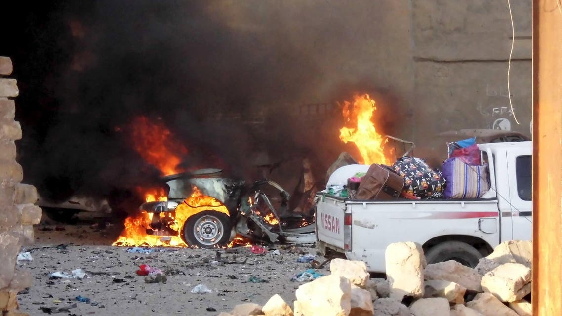 A car is engulfed by flames during clashes in the city of Ramadi. (Reuters)