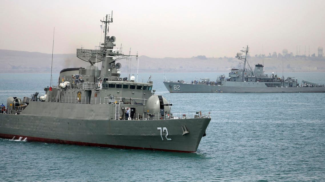 In this picture taken on Tuesday, April 7, 2015, and released by the semi-official Fars News Agency, Iranian warship Alborz, foreground, prepares before leaving Iran's waters. (AP)