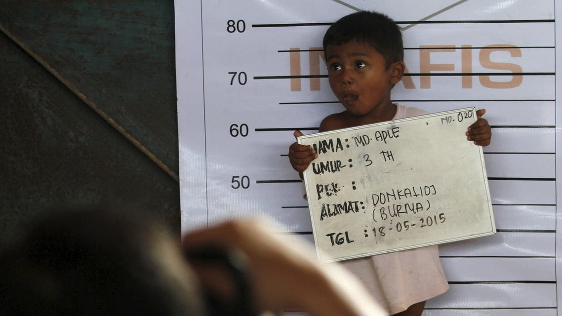 A Rohingya child who recently arrived by boat has his picture taken for identification purposes at a shelter in Kuala Langsa, in Indonesia's Aceh Province, May 18, 2015. The United Nations has called on Southeast Asian nations not to push back the boatloads of Rohingya Muslims from Myanmar and Bangladeshis - men, women and children who fled persecution and poverty at home, and now face sickness and starvation at sea. REUTERS/Roni Bintang