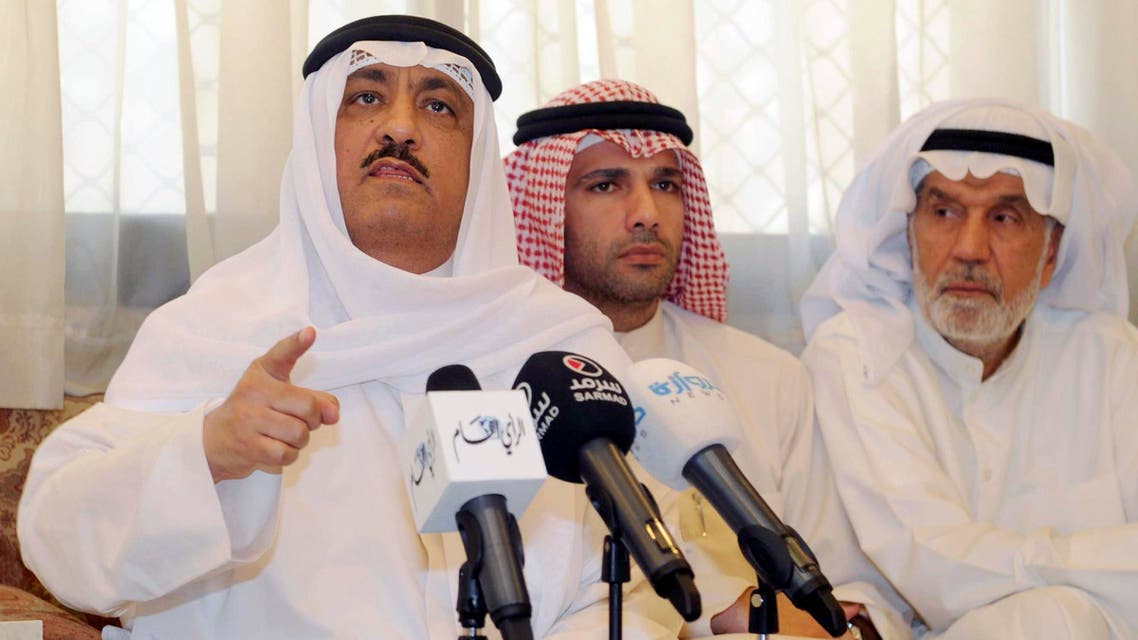 Former Kuwaiti lawmaker Musallam al-Barrack, left, speaks at his residence after Kuwait's supreme court upheld a verdict on charges he insulted the country's ruler, in Kuwait city, Kuwait, Monday, May 18, 2015. AP