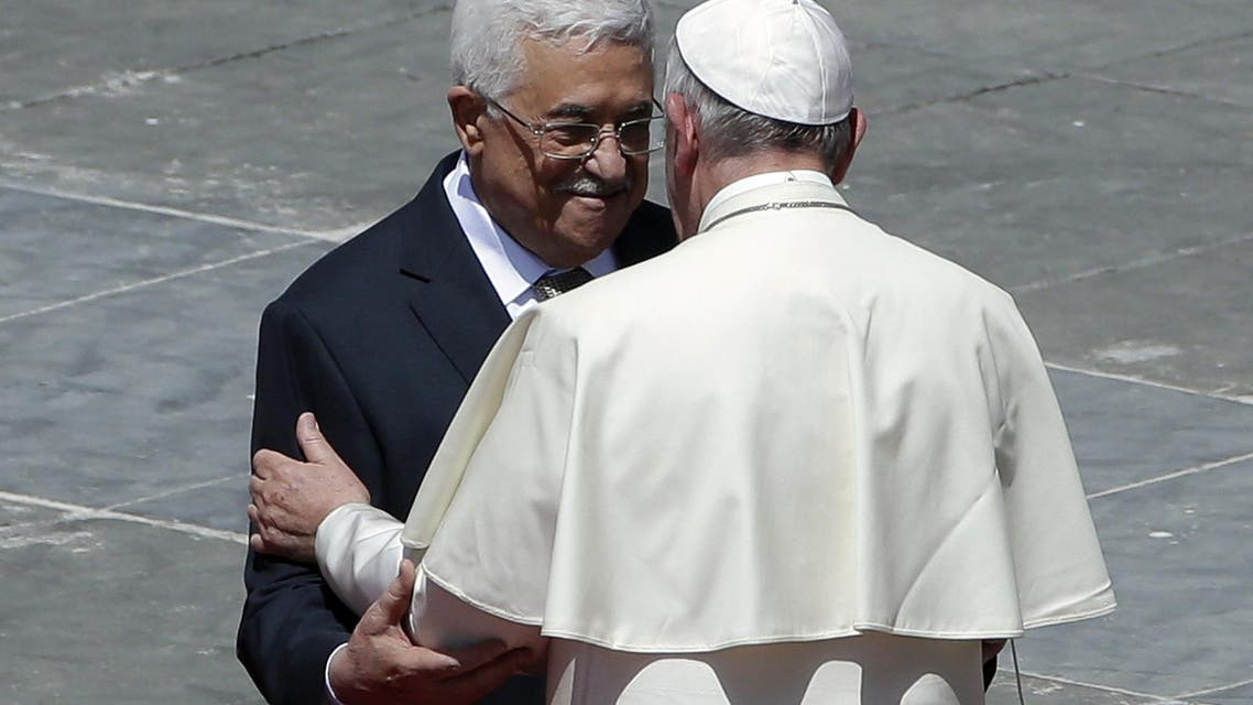 Pope Francis greets Palestinian President Mahmoud Abbas following a canonization ceremony in St. Peter's Square at the Vatican, Sunday, May 17, 2015. Pope Francis canonized two nuns from what was 19th century Palestine on Sunday in hopes of encouraging Christians across the Middle East who are facing a wave of persecution from Islamic extremists. Sisters Mariam Bawardy and Marie Alphonsine Ghattas were among four sisters who were made saints Sunday at a Mass in a sun-soaked St. Peter's Square. (AP Photo/Alessandra Tarantino)
