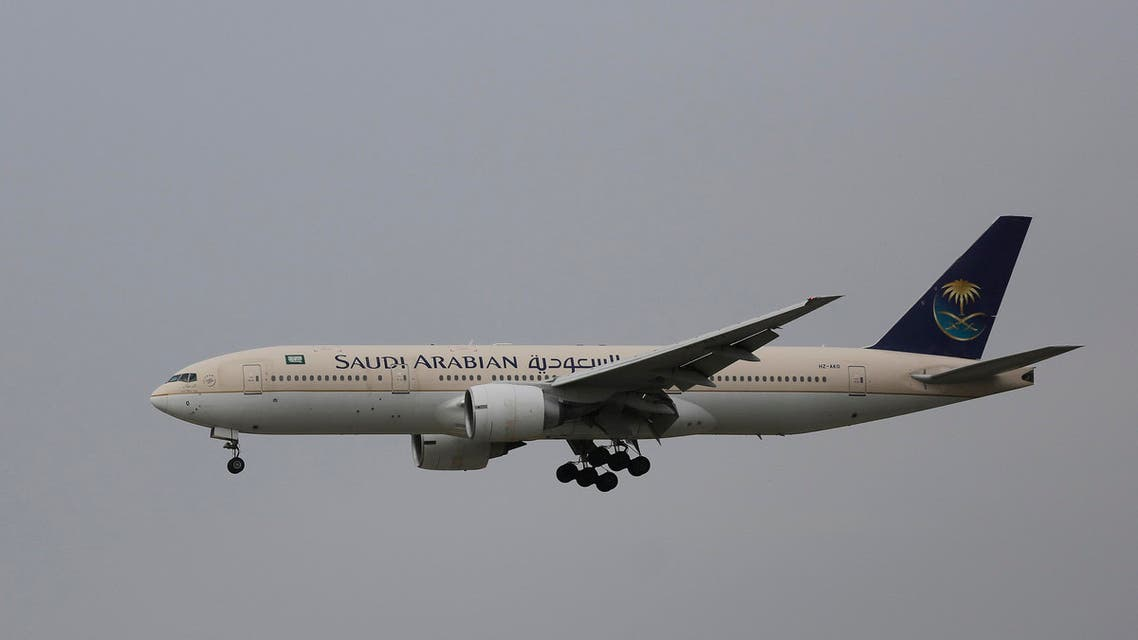 In this Thursday, April 16, 2015 photo, a passenger aircraft of the Saudi Arabian Airlines prepares for landing at the Indira Gandhi International Airport in New Delhi, India. (AP Photo/Altaf Qadri)