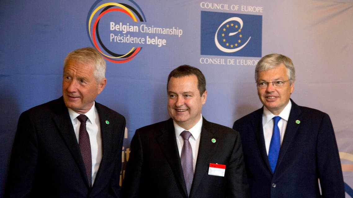 Secretary General of the Council of Europe Thorbjorn Jagland, left, and Belgian Foreign Minister Didier Reynders, right, welcome Serbia's Foreign Minister Ivica Dacic during a meeting of the Council of Europe in Brussels on Tuesday, May 19, 2015. The Council of Europe meets Tuesday with ministers of state to discuss terrorism. (AP Photo/Virginia Mayo)