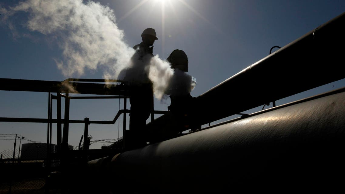 In this Feb. 26, 2011 file photo, a Libyan oil worker, works at a refinery inside the Brega oil complex, in Brega, eastern Libya. AP
