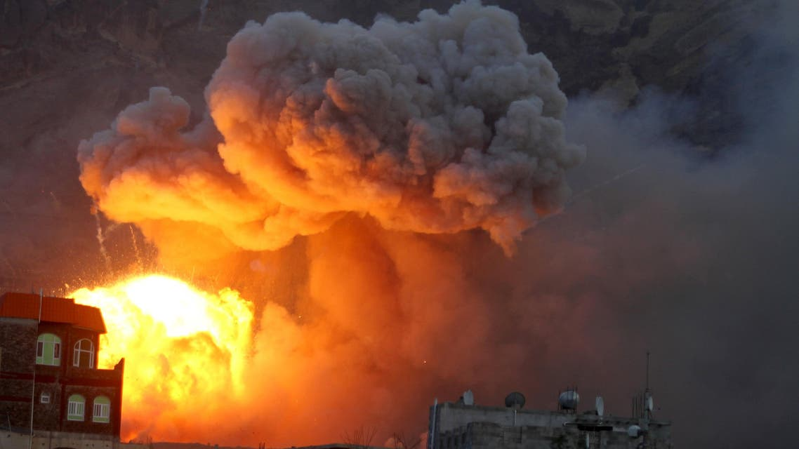 Fire and smoke billows from an army weapons depot after it was hit by an air strike in Yemen's capital Sanaa reuters