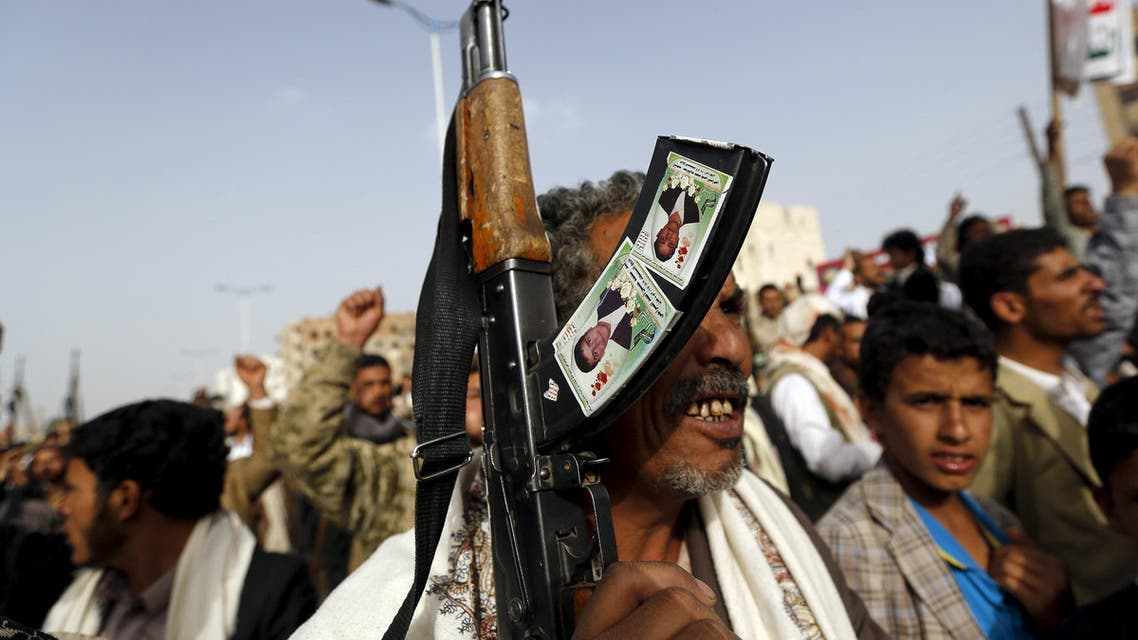Houthi follower holds his rifle as he demonstrates against Saudi-led air strikes in Yemen's capital Sanaa