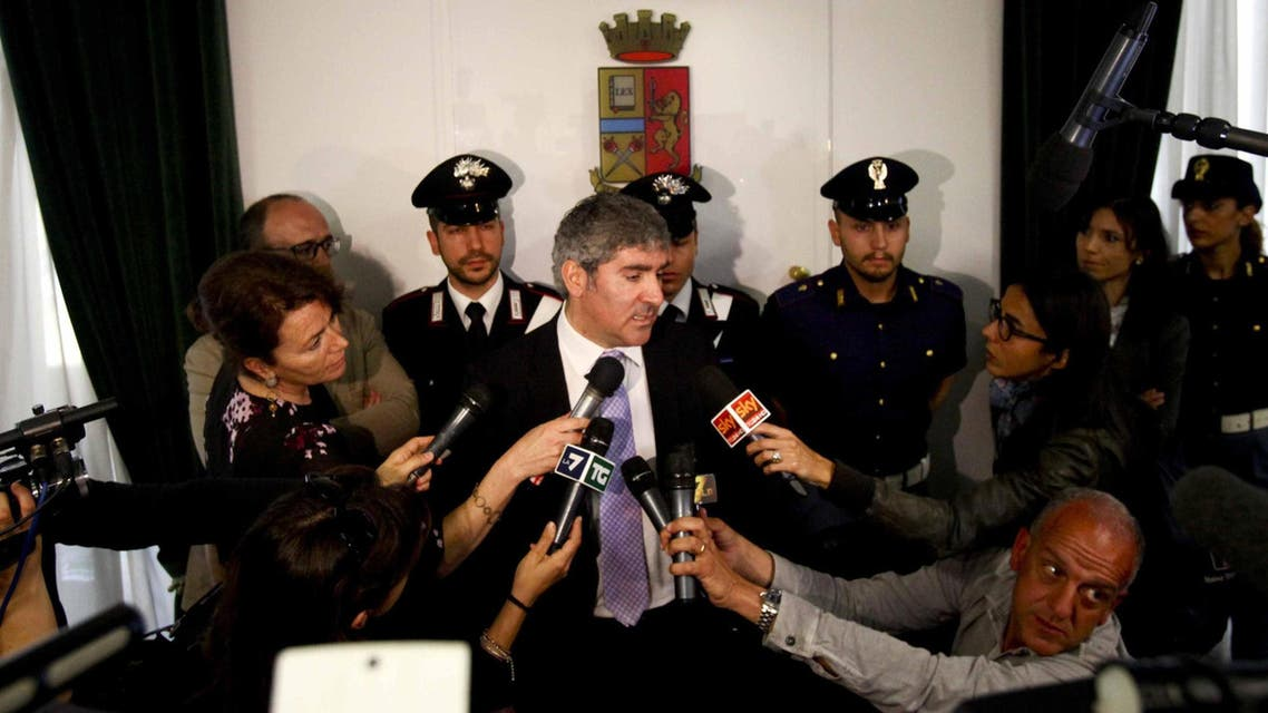 Milan chief anti-terrorism investigator Bruno Megale, center, speaks during a press conference in Milan, Italy, Wednesday, May 20, 2015. AP