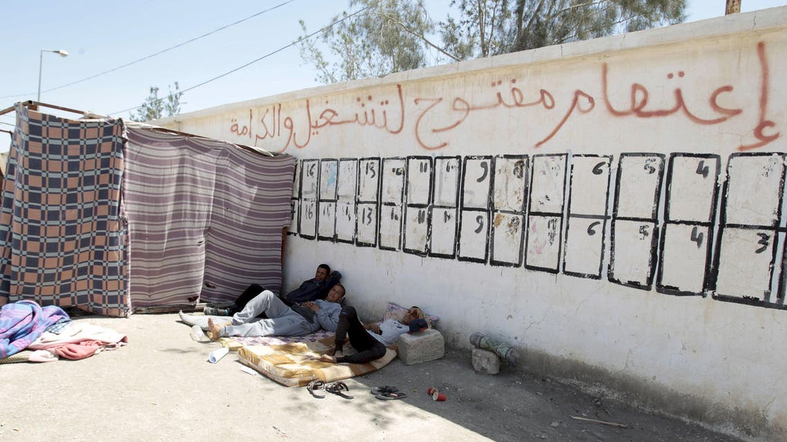 Protesters are seen near tents in Metlaoui, Tunisia May 11, 2015. Reuters