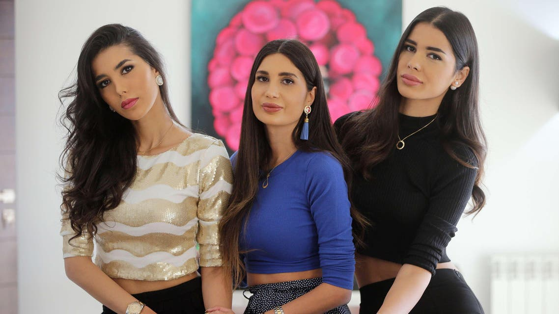 """Stars of the Lebanese television reality show """"The Sisters"""" Nadine (L) Alice (C) and Farah (R), known as Abdel Aziz sisters, pose for a picture at their villa in the upscale area of Beit-Misk north east of the capital, Beirut, on April 1, 2015. (AFP)"""