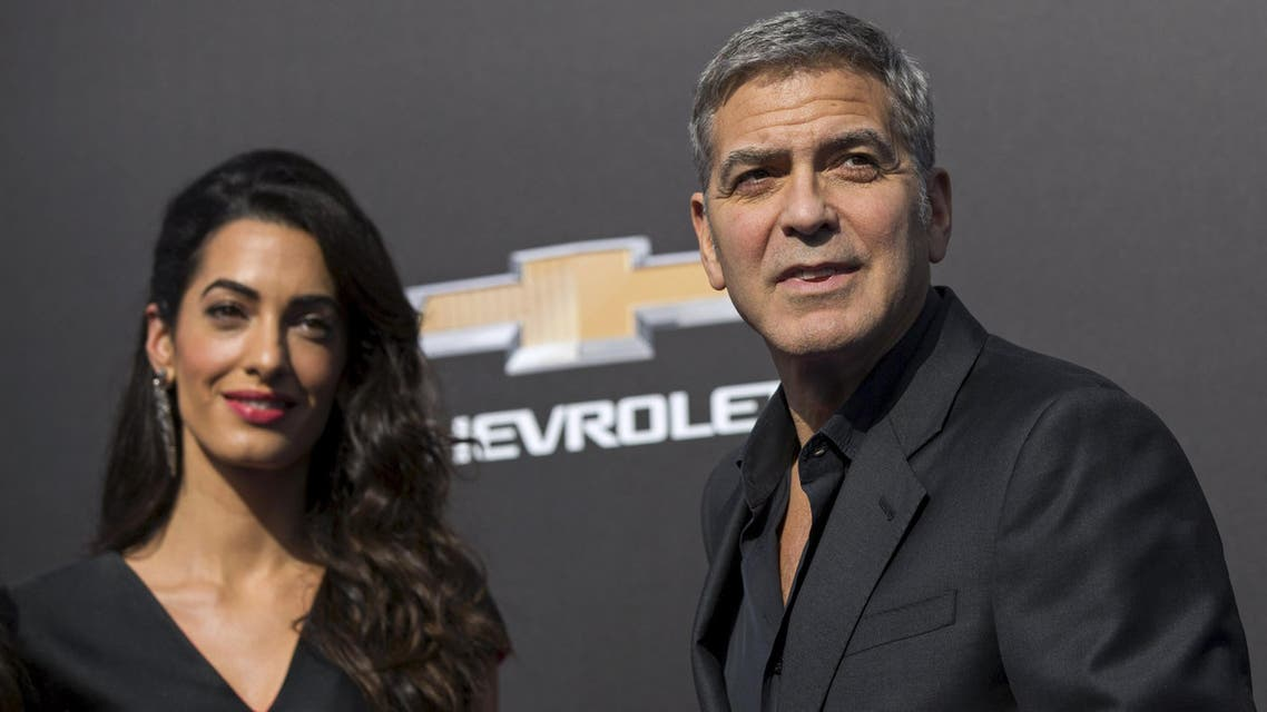 """Cast member George Clooney and his wife Amal pose at the premiere of """"Tomorrowland"""" in Anaheim, California May 9, 2015.  (Reuters)"""