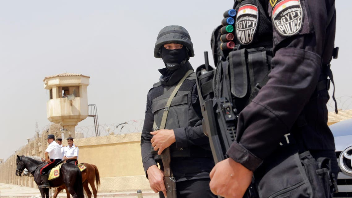 Egyptian policemen secure Egypt's national police academy, where an Egyptian criminal court sentenced ousted Islamist President Mohammed Morsi and 12 Brotherhood leaders and Islamist supporters to 20 years in prison over the killing of protesters in 2012, in Cairo, Egypt, Tuesday, April 21, 2015. AP