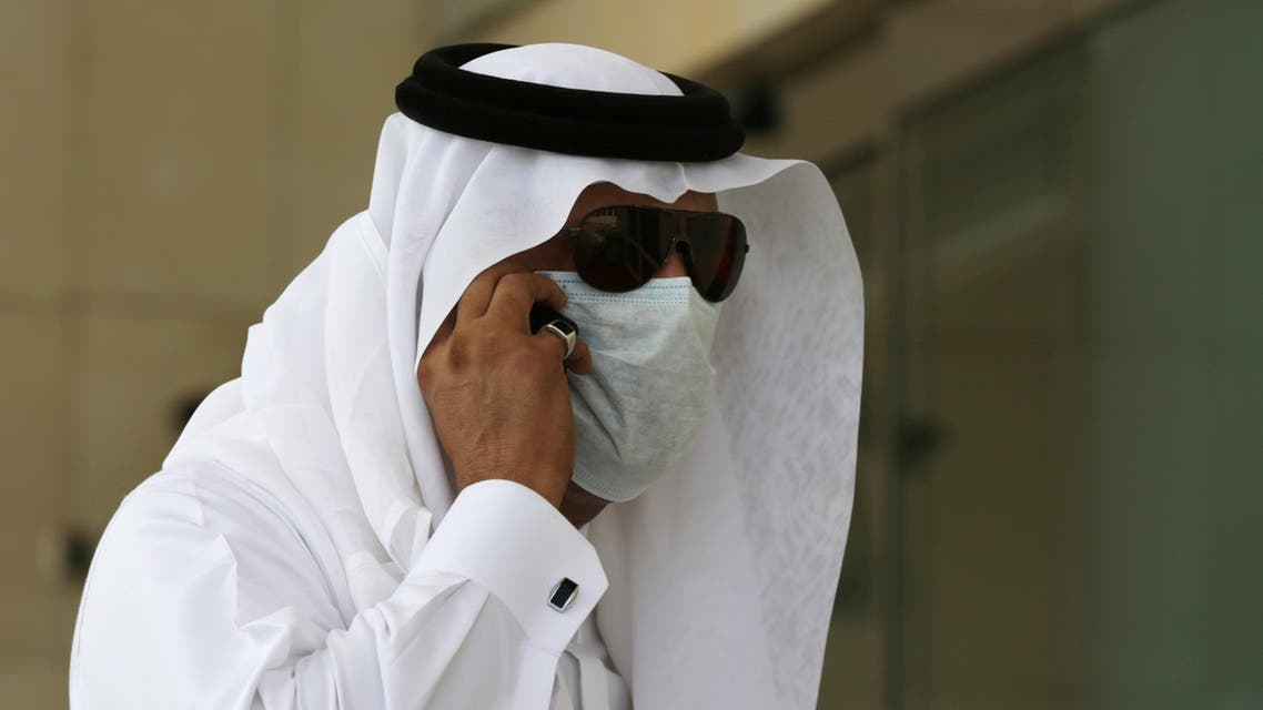 A Saudi man talks in his phone wears a mask outside King Fahd hospital in Jeddah, Saudi Arabia, Friday, May 9, 2014. Five more people have died in Saudi Arabia after contracting an often fatal Middle East respiratory virus as the number of new infections in the kingdom climbs higher, health officials confirmed Thursday. (AP Photo/Hasan Jamali)