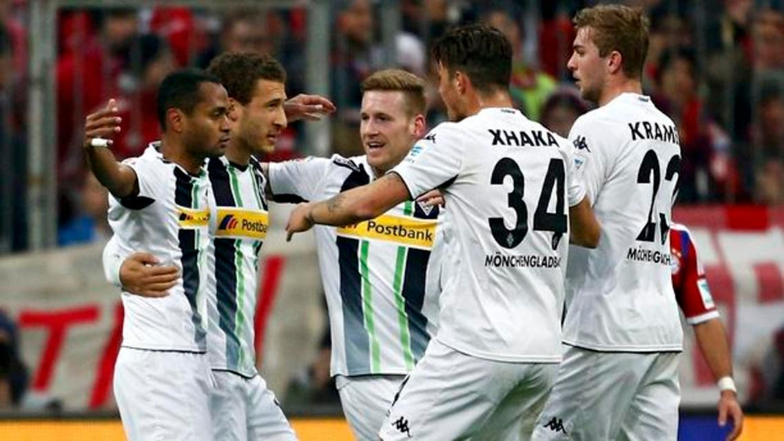 Borussia Mönchengladbach's players celebrate after taking the lead against Bayern Munich. Reuters
