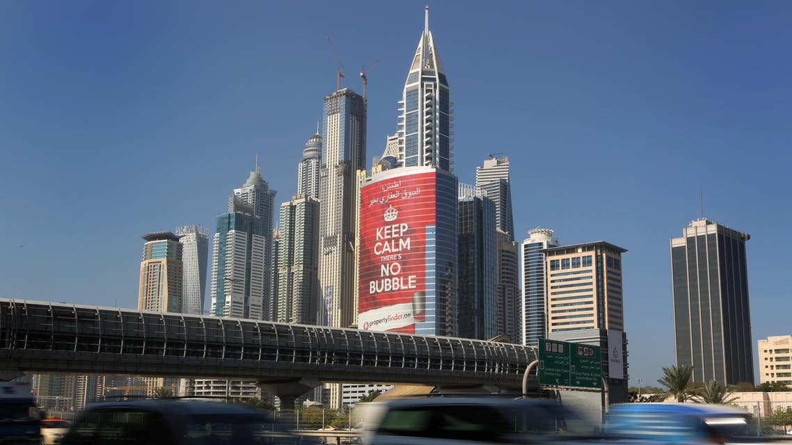 """this Wednesday Nov. 13, 2013 photo, vehicles pass by a tower with a sign that reads, """"Keep Calm, No Bubble,"""" at the Marina district in Dubai, United Arab Emirates. (File photo: AP)"""