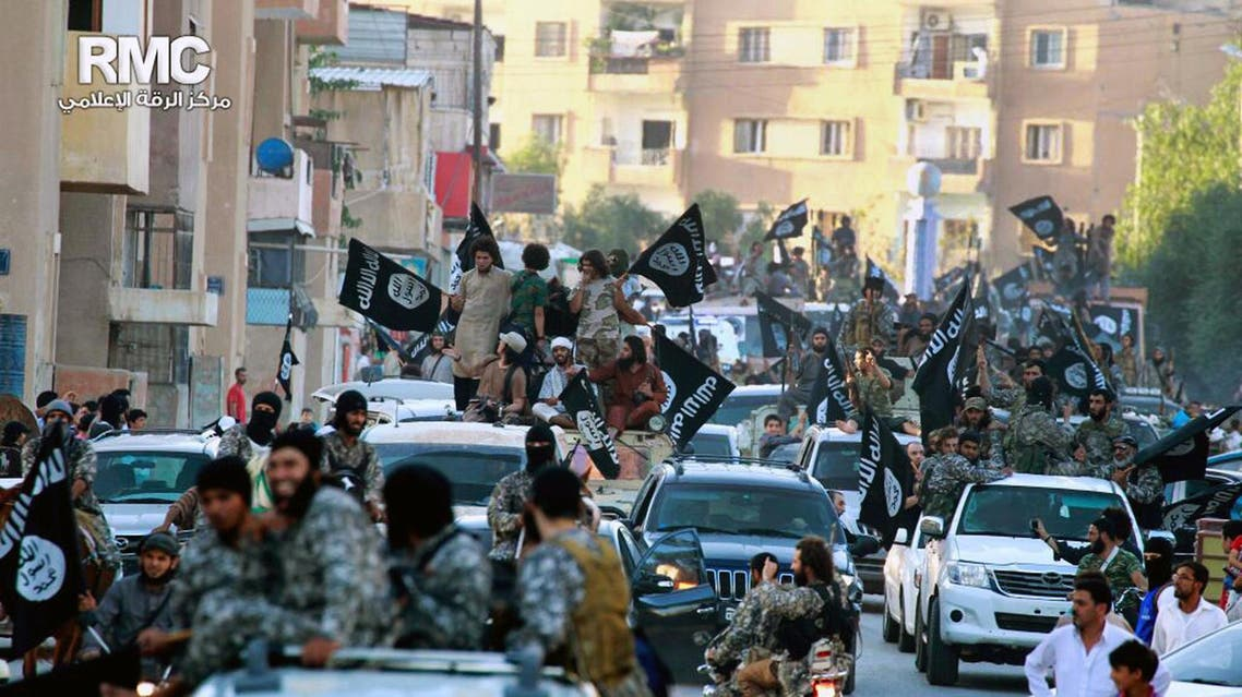 In this undated file image posted on Monday, June 30, 2014, by the Raqqa Media Center of the Islamic State group, a Syrian opposition group, which has been verified and is consistent with other AP reporting, fighters from the Islamic State group parade in Raqqa, north Syria. AP