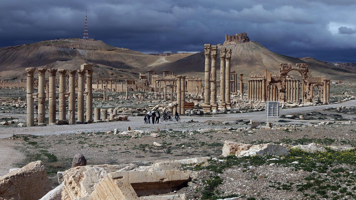 A file picture taken on March 14, 2014 shows the citadel (background) of the ancient oasis city of Palmyra, 215 kilometres northeast of Damascus, over looking the city. AFP