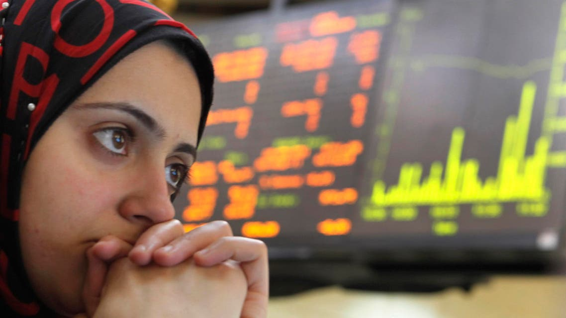 An Egyptian trader reacts after trading was halted for 30 minutes on the Egyptian Exchange after the benchmark index fell 5 percent, tracking a plunge in other world markets at the stock market, in Cairo, Egypt, Tuesday, Aug. 9, 2011. AP