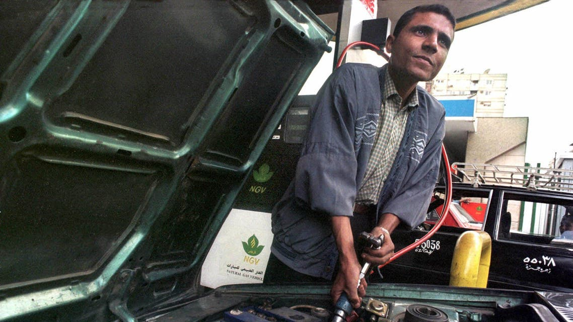 A gas station attendant refuels a vehicle with compressed natural gas at one of Cairo's 14 fueling stations. (File: AP)