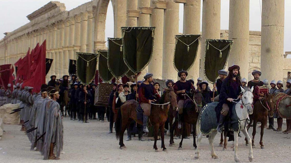 """FILE - In this Sept. 27, 2002, file photo, a symbolic trade caravan representing the prosperous trade during the era of Queen Zanobya 260-273AD attend a show held in the ancient city of Palmyra, some 240 kilometers (150 miles) northeast of Damascus, Syria. A Syrian official said on Sunday that the situation is """"fully under control"""" in Palmyra despite breaches by Islamic State militants who pushed into the historic town a day earlier. (AP Photo/Bassem Tellawi, File)"""