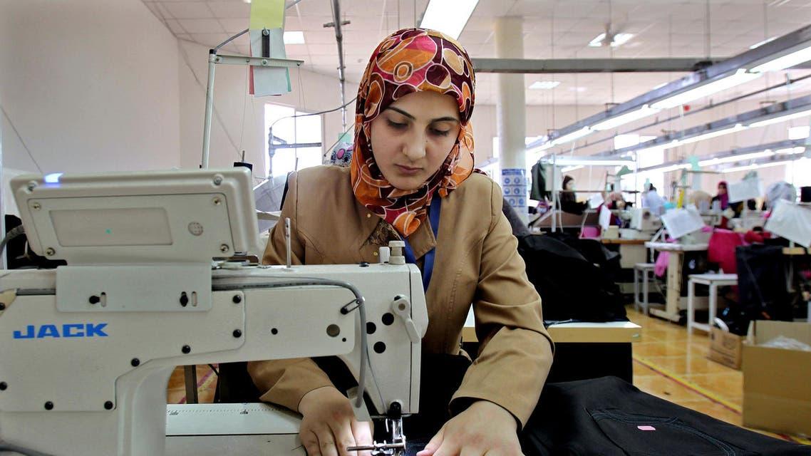 Jordanian women sew jeans for the U.S. market in a garment factory in the village of Kitteh in northern Jordan. (AP)