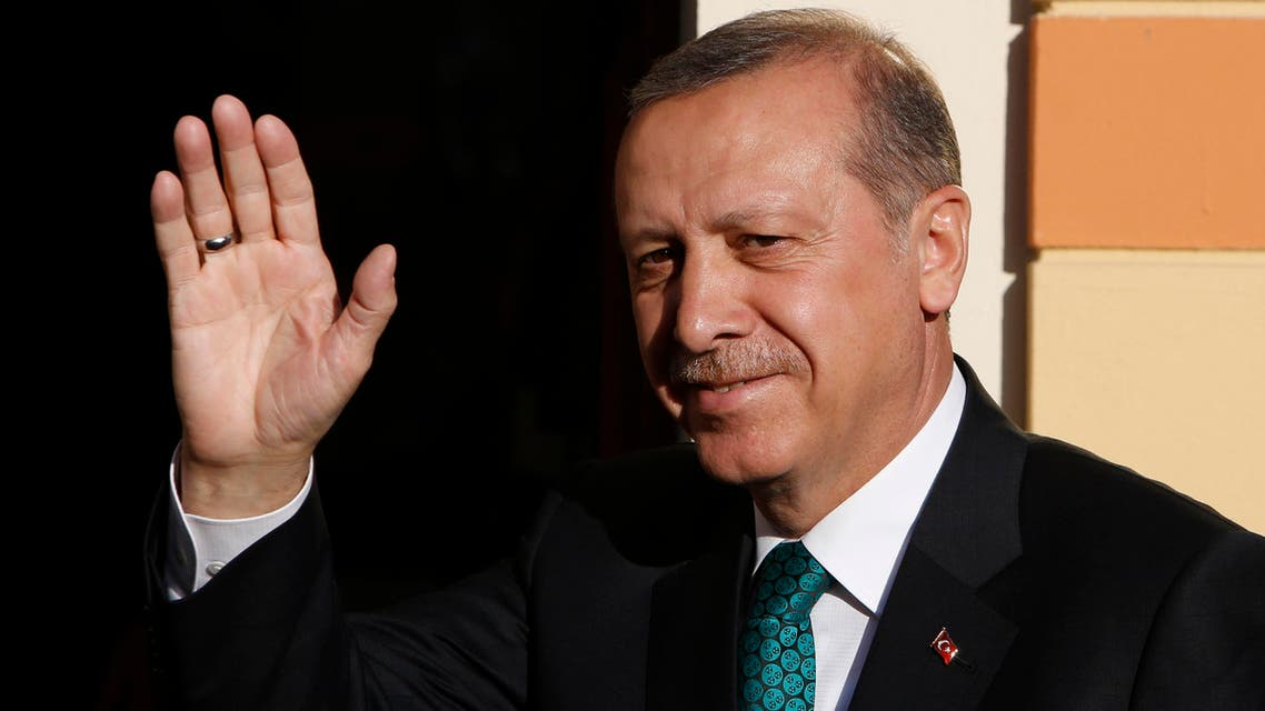 Turkish President Recep Tayyip Erdogan, wave to supporters in the Bosnian capital of Sarajevo, on Wednesday, May 20, 2015. AP