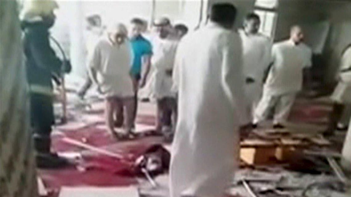 People are seen looking at debris scattered around the floor of a mosque in Al-Qadeeh, Saudi Arabia in this May 22, 2015 still image taken from video courtesy of Abo Kadi Al Numer. (Reuters)