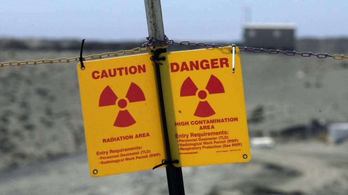 In this April 3, 2008 file photo, a sign warns of radiation on the Hanford nuclear reservation near Richland, Wash. (AP Photo/Ted S. Warren, File)