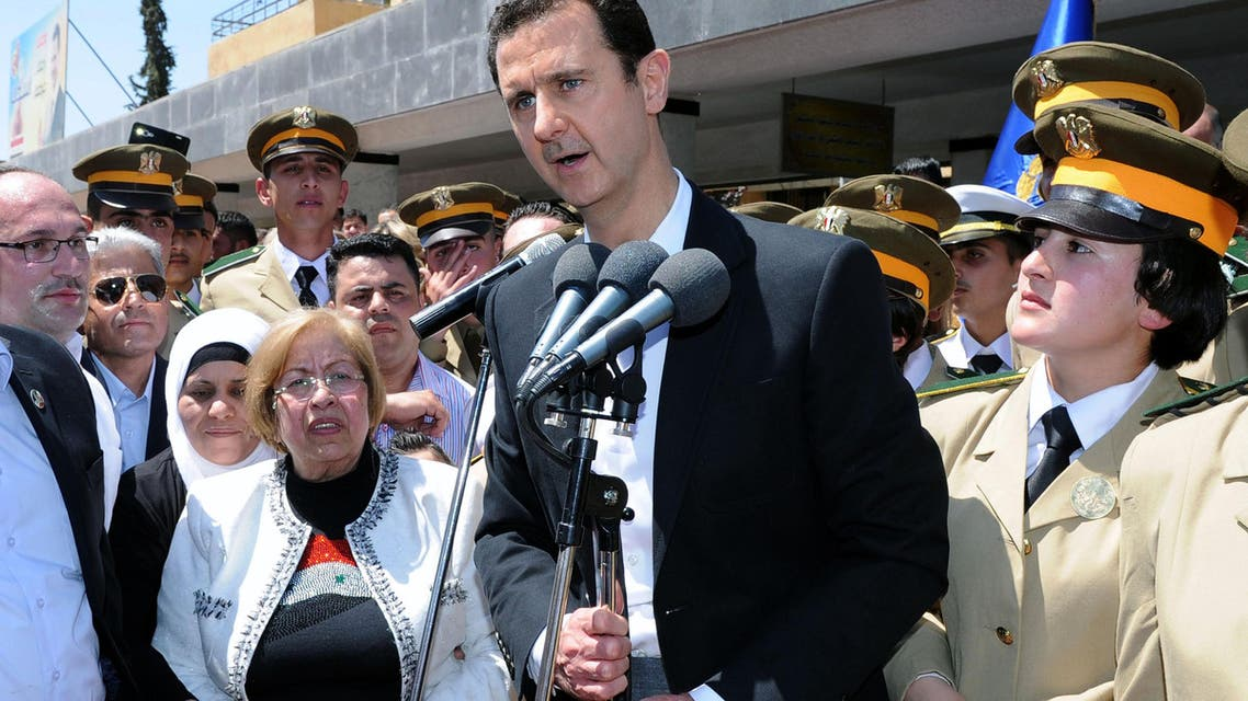 In this photo released by the Syrian official news agency SANA, Syrian President Bashar Assad speaks during a public appearance at a school in Damascus, Syria, Wednesday, May 6, 2015. (AP)