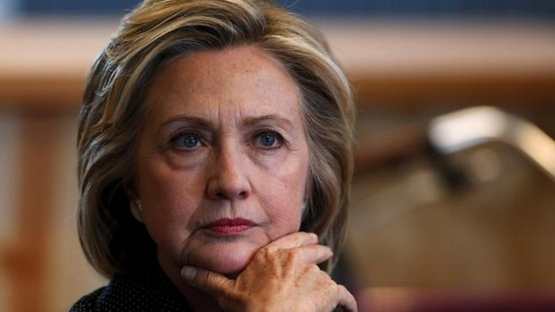 U.S. presidential candidate Hillary Clinton listens to remarks at a roundtable campaign event with small businesses in Cedar Falls, Iowa, United States, May 19, 2015. REUTERS/Jim Young