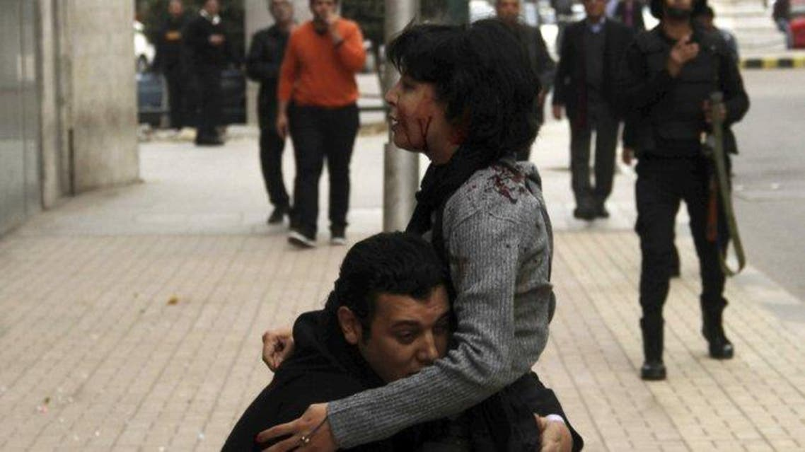 A photograph showing Shaimaa el-Sabbagh with blood running down her face as she is held up by a colleague became an iconic image that was widely shared on social media. (Reuters)