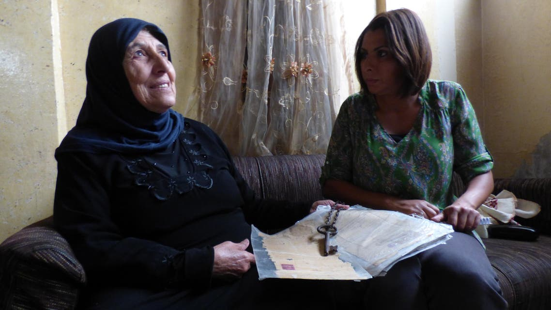 Journalist Nabila Ramdani with Fatma Hussein Omar, 67, showing the key and the legal documents to her home confiscated by Israel's Zionist paramilitaries in 1948 - hoping to return there. (Al Arabiya/ Nabila Ramdani)