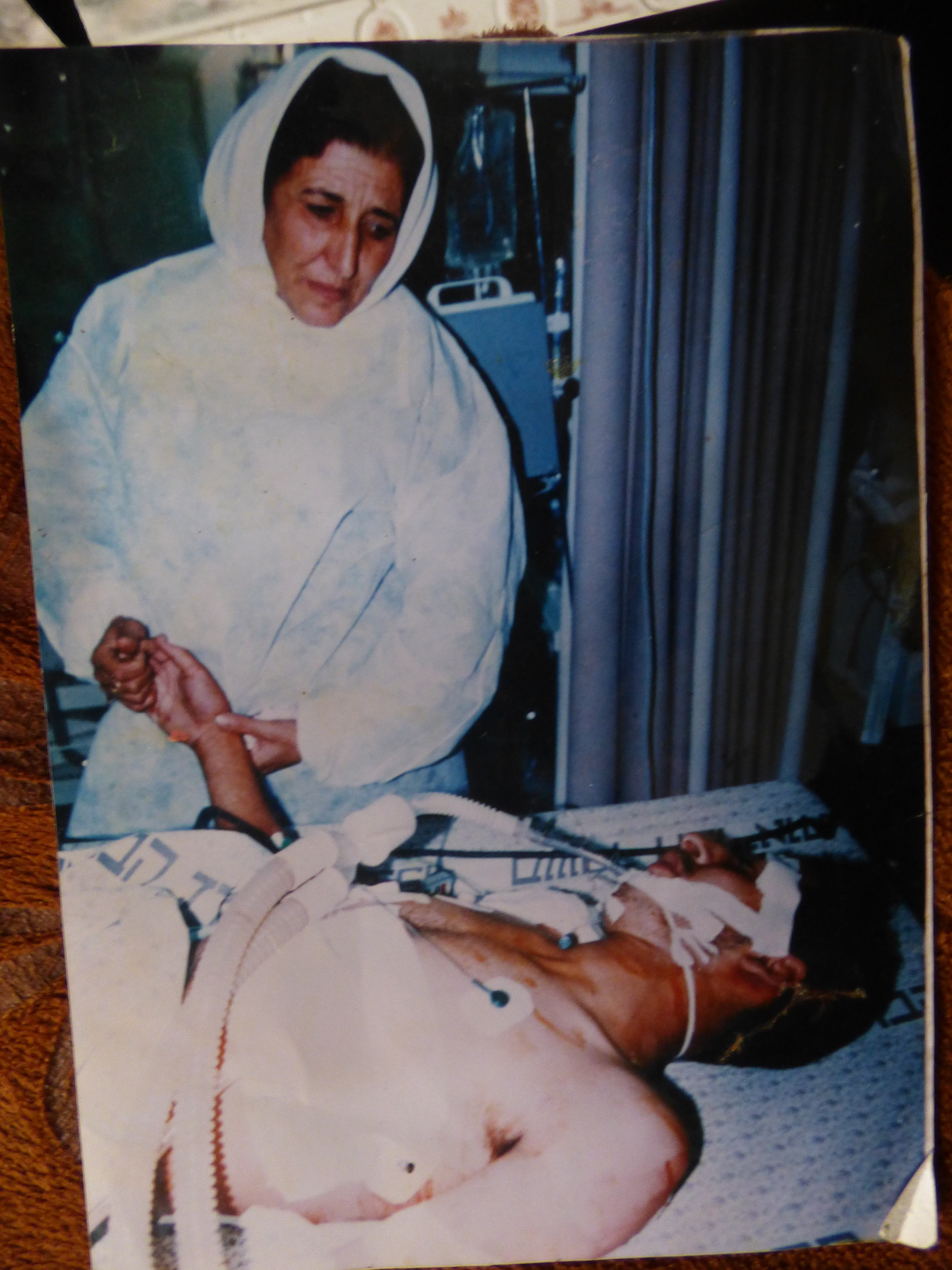 Fatma and her son Ahmed in 1994 after he was shot in the chest by Israeli soldiers with a dum-dum bullet that damaged his spinal cord.  (Al Arabiya/ Nabila Ramdani)